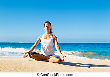Woman Practicing Yoga - attractive woman practicing yoga by...