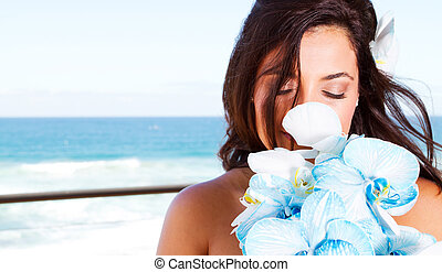 cute young bride smelling bouquet