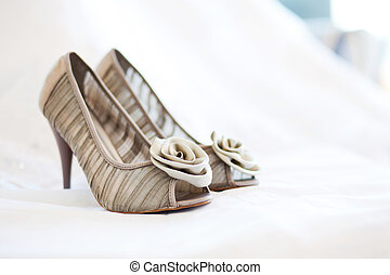 bridal wedding shoes on white