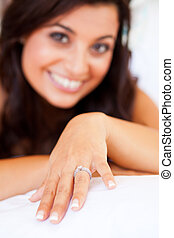 happy bride showing her wedding ring