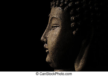 Buddhism - Profile of Buddha head on a black background with...