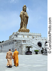Monks and Guan Yin - Two monks and statue of godness Guan...