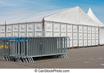 Crush barriers near a big marquee