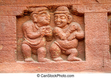 Dwarfs - Stone carving of dwarfs on the base wall of cave...