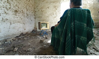 Senior Woman Watching Old TV In An Abandoned House, Dolly...