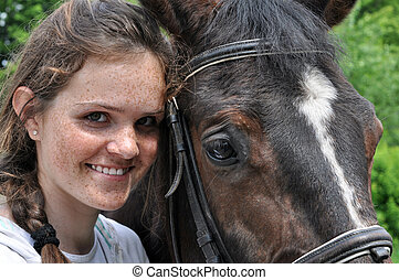 teenage girl and horse - happy teenage girl and horse in...