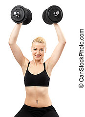 Athletic young lady working out with weights - Athletic...