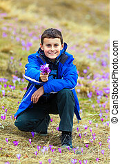 Boy offering a bunch of flowers