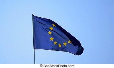 EU flag against the blue sky