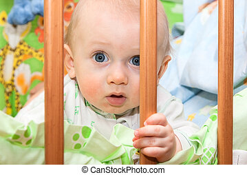 baby boy in the crib - seven-months baby boy in the crib,...