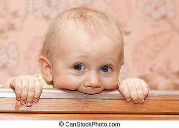 Teething Baby - Baby boy gnaw a stick in bed