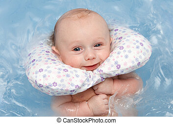 baby swim in blue bathtub
