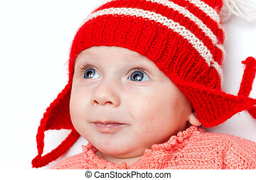 Happy boy in red hat - Cute smiling baby in red hat on white