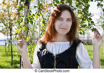 Medieval woman near the birch - Medieval woman standing near...