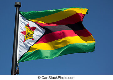 Zimbabwe Flag - The Zimbabwe Flag blowing in the wind with...