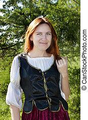 Medieval woman near the fir - Medieval woman standing near...