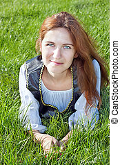 Medieval woman on the grass - Medieval woman laying on the...