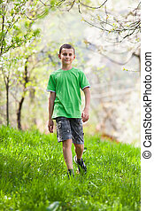 Boy walking outdoor - Full length portrait of a boy walking...