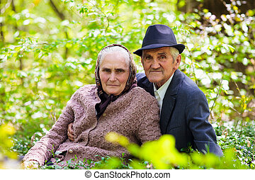 Senior couple relaxing outdoor - Senior couple sitting in...