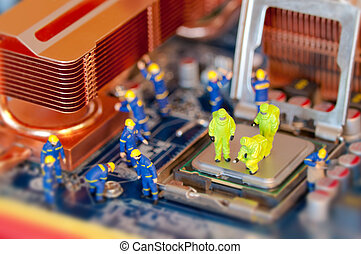 Technicians repairing computer - Group of Technicians...