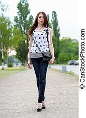 Sexy young woman walking