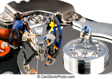 Hard disk repair concept - Group of construction workers...