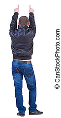 Back view of pointing  man in jeans and jacket