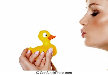 I love my ducky. - A beautiful woman pouting her lips to...