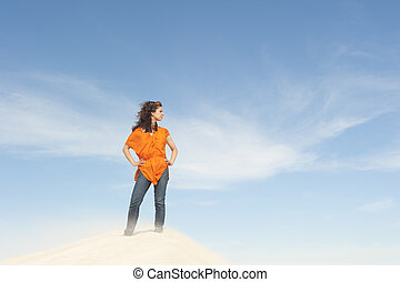 Beautiful and confident woman on top of hill - An attractive...