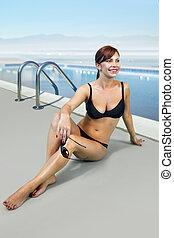 woman in black bathing suit on beach l - happy woman in...
