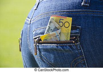 money in a blue jeans back pocket - 50 Australian Dollars...