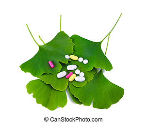 ginkgo leaf - Ginkgo leaves and pills isolated on white