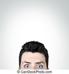 Shocked - Young man surprised with wide open eyes and copy...