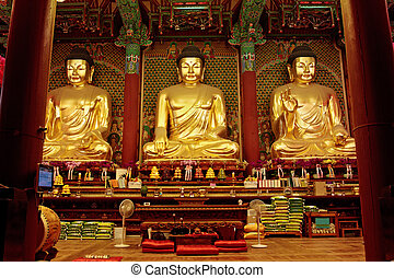 Golden Buddha in Jogyesa temple (Seoul) - Three golden...