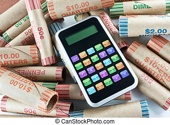 Calculator Sitting On Coin Wrappers