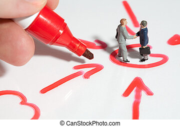 Business handshake sealing the deal - Two tiny miniature...