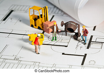 Building site and blueprint - Tiny toy model figures of...