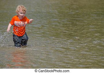 Happy Boy Playing In The Water