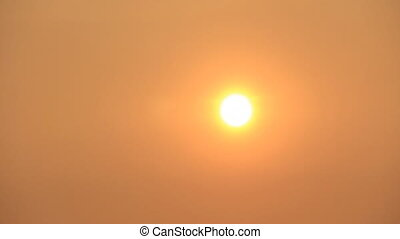 Hot summer - Hot sun disk on the warm orange sky