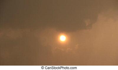 Sun disk through rain