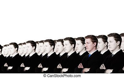 stand out - businessman standing out from the crowd when all...