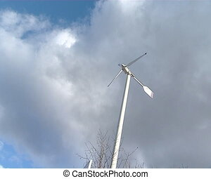 clean energy production - small windmill spinning in blue...