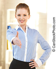 woman with an open hand ready for handshake - bright picture...