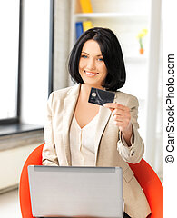 happy woman with laptop computer and credit card - picture...