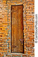 The Old door on brickwall