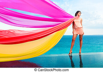 Woman with scarfs - Woman with colorful scarfs on water