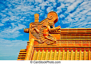 The Dragon on roof isolated on blue sky background