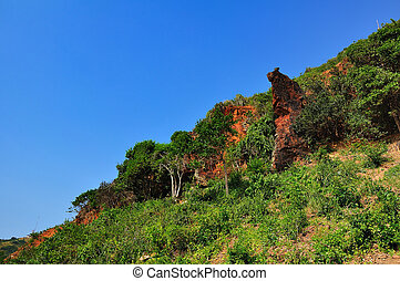 Rocky landscape in blue sky