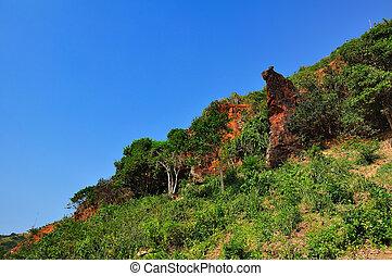 Rocky landscape in blue sky