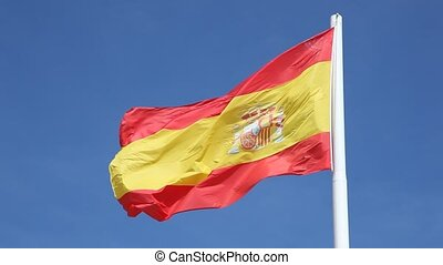 Spanish national flag against a blue sky